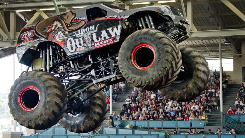 """The """"Iron Outlaw"""" monster truck gets airborne during last year's competition at the San Diego County Fair."""