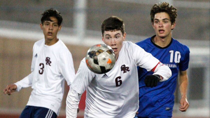 SAN DIEGO, February 28, 2018 | Scripps Ranch's Timothy Phillips goes after the ball while followed b