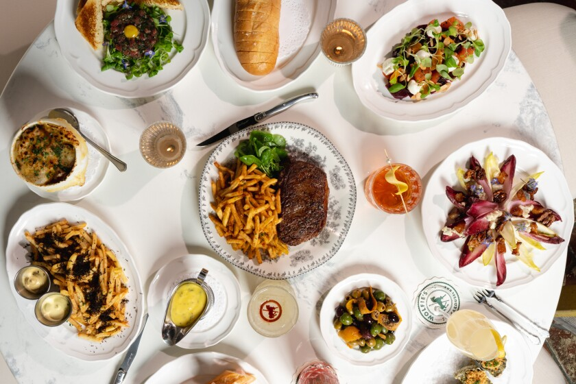 Wolfie's Carousel Bar in Little Italy serves a limited French-inspired menu.