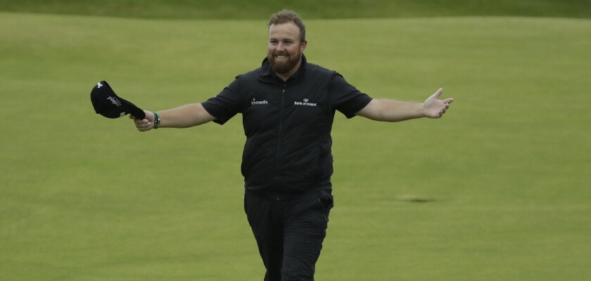 Ireland's Shane Lowry walks with his arms outstretched as he acknowledges the crowd on the 18th green during the final round of the British Open on Sunday.