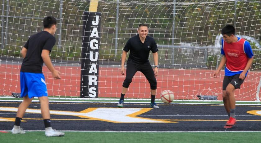 SAN DIEGO, CA January 30th, 2018 | Valley Center High School soccer coach Julio Ruiz (middle) practi