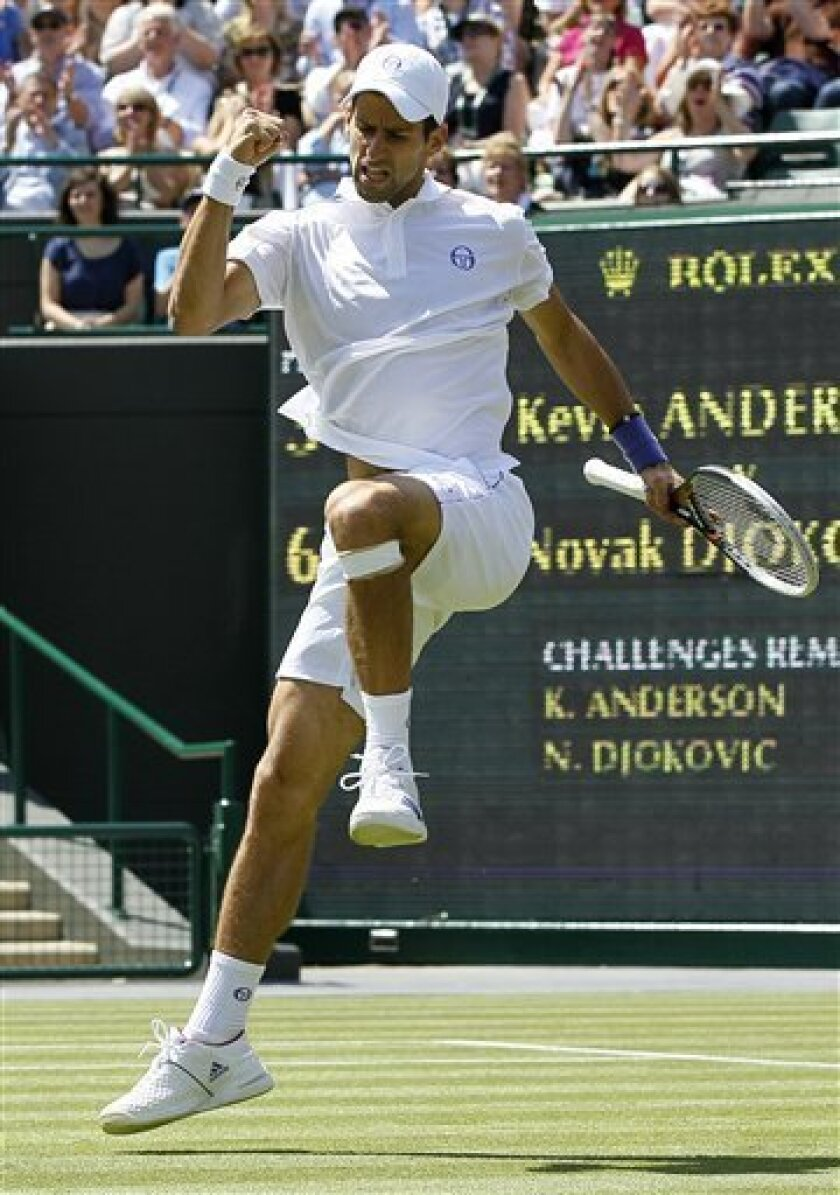 Serbia's Novak Djokovic reacts during the match against South Africa's Kevin Anderson at the All England Lawn Tennis Championships at Wimbledon, Thursday, June 23, 2011. (AP Photo/Kirsty Wigglesworth)