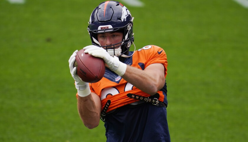 Denver Broncos tight end Jake Butt takes part in drills during an NFL football practice in empty Empower Field at Mile High, Saturday, Aug. 29, 2020, in Denver. (AP Photo/David Zalubowski)