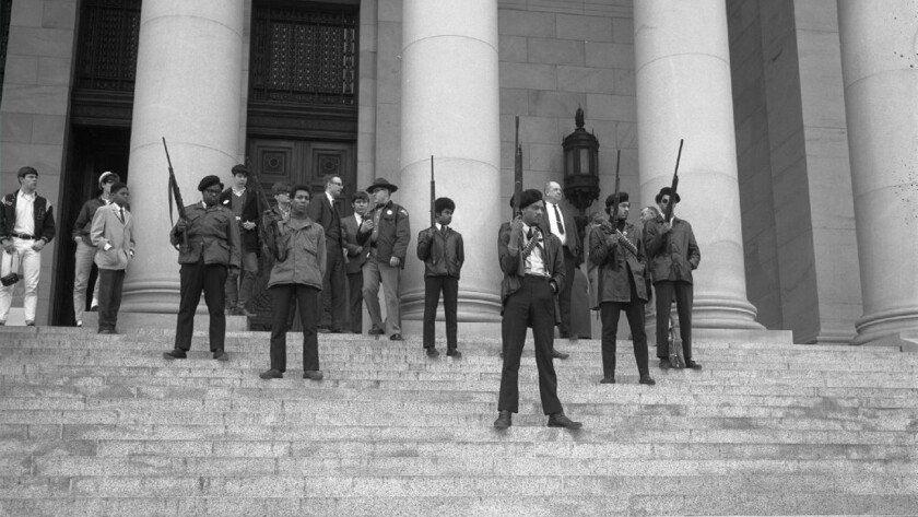 Black Panther members, emulating a protest by party members in Sacramento, stand on the Washington state Capitol steps to protest a gun bill in 1969.