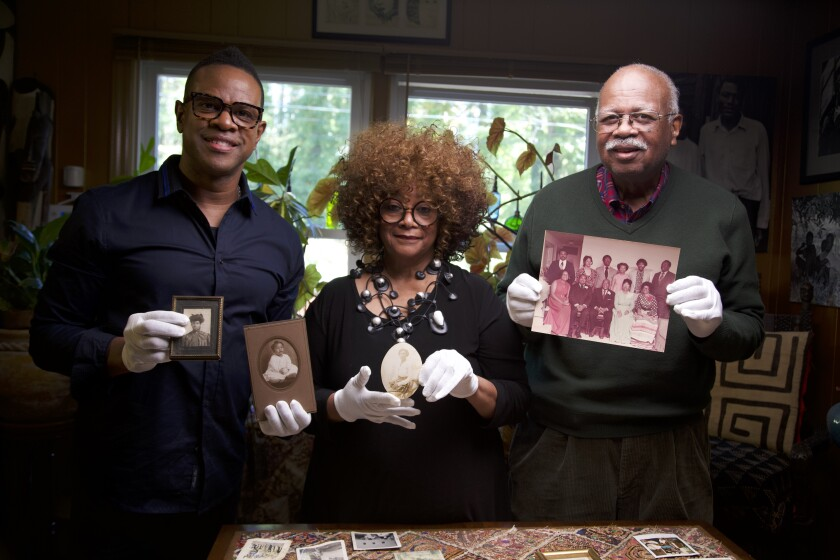 "Filmmaker Thomas Allen Harris with North Carolina poet laureate Jaki Shelton Green, and her cousin Sterling Michael Holt for the PBS series ""Family Photos USA."""