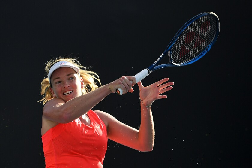 CoCo Vandeweghe plays a forehand during her first-round match against Laura Siegemund at the 2020 Australian Open on Jan. 21 in Melbourne.