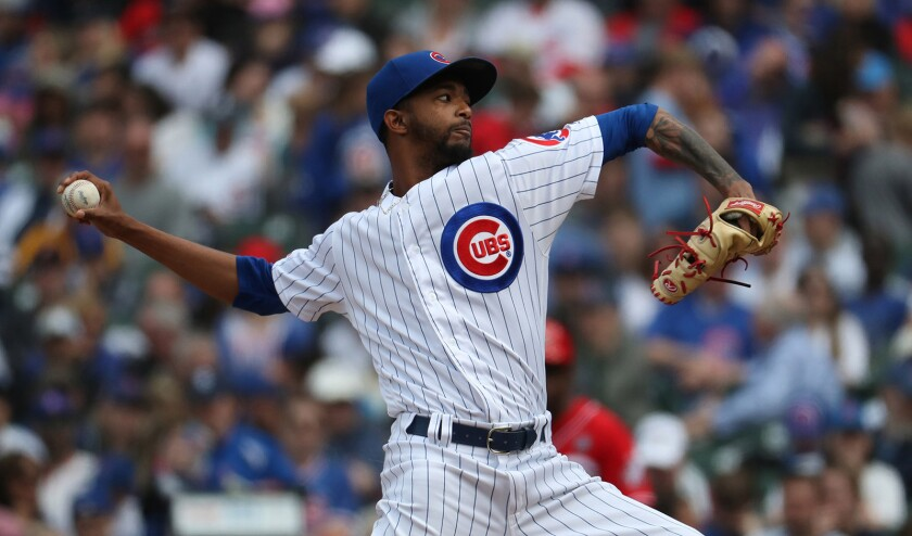 Chicago Cubs relief pitcher Carl Edwards Jr. delivers to the Cincinnati Reds in the sixth inning on Sunday, May 26, 2019 at Wrigley Field in Chicago, Ill.