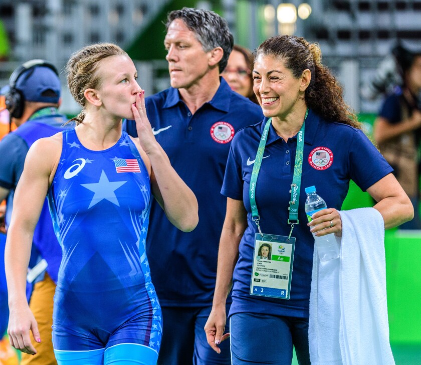 El Cajon's Afsoon Johnston escaped danger, oppression in Iran to become the first U.S. woman to win a world wrestling medal.