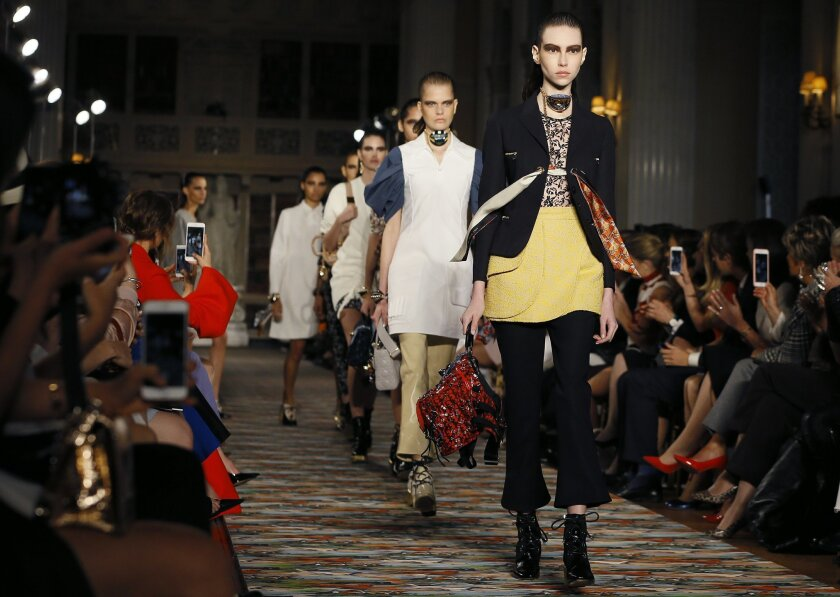Models display creations during the Dior Cruise 2017 fashion show at Blenheim Palace in Woodstock, Oxfordshire in England, Tuesday, May 31, 2016. (AP Photo/Kirsty Wigglesworth)