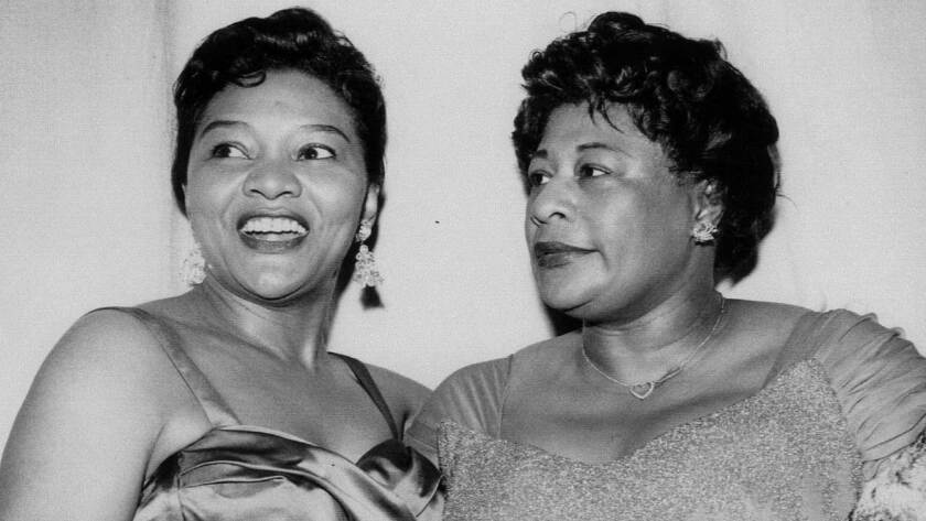 Singer Ella Fitzgerald, right, with actress Juanita Moore at the Pantages Theatre in Hollywood.