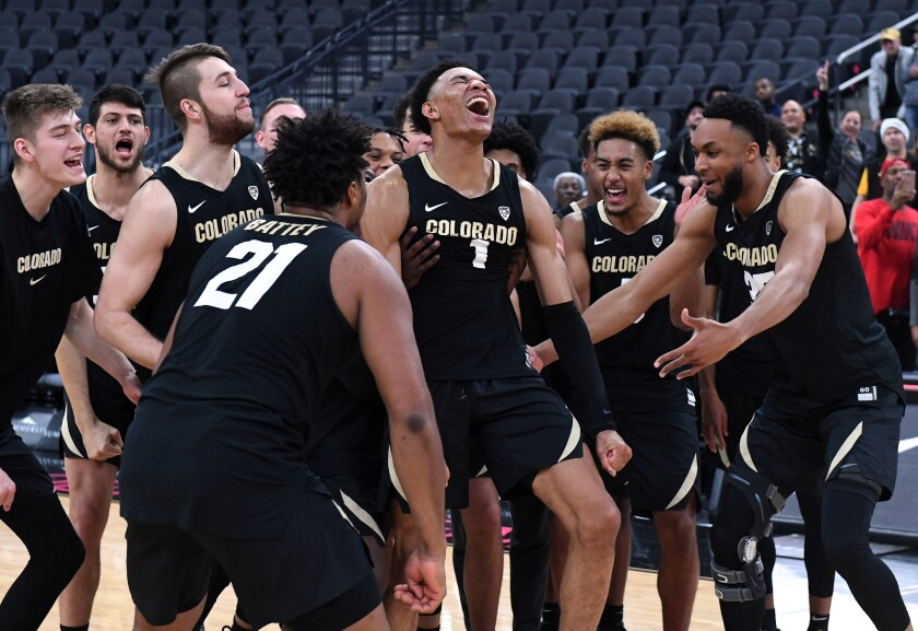 Colorado junior guard Tyler Bey (1) celebrates with teammates after being declared the MGM Resorts Main Event basketball tournament MVP on Nov. 26.