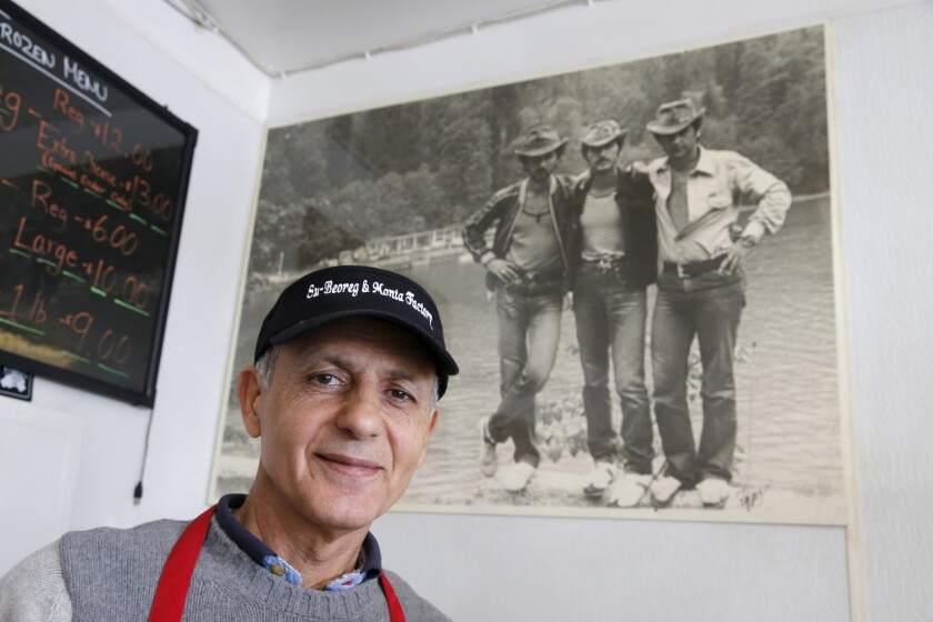 Grant Yegiazaryan is shown with a photo of himself as a young man (at right) with his two friends at the Black Sea in Soviet Russia in 1978, before he immigrated to the U.S. where he, his wife and son run the manti-making Monta Factory in Pasadena.