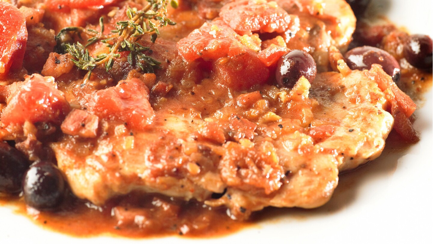 Chicken breasts are topped with a sauce of tomatoes, olives, herbs and rich pancetta. Recipe: Basque-style chicken