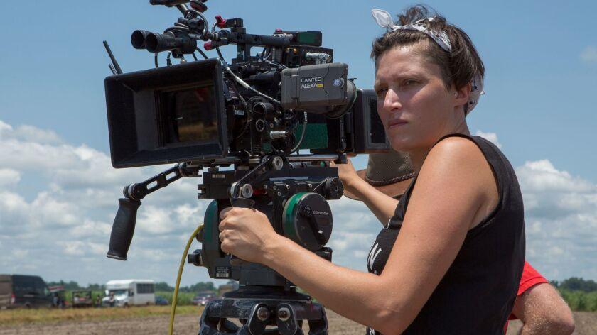 "Cinematographer Rachel Morrison on the set of ""Mudbound."" Credit: Steve Dietl / Netflix"