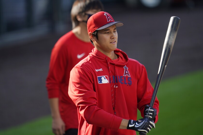 Shohei Ohtani warms up before a spring training game.