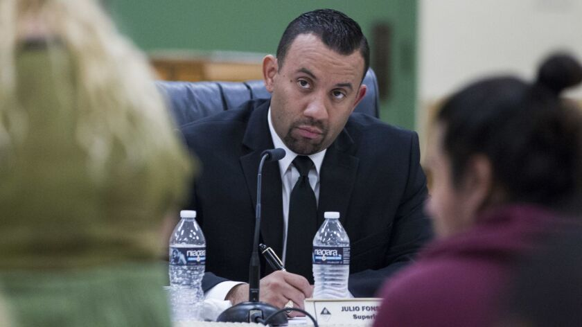 Former San Ysidro School District Superintendent Julio Fonseca listens to public comments during a school board meeting in February 2017.