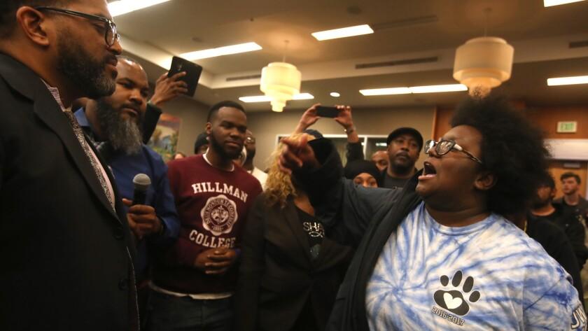 Activists disrupt the Sacramento council meeting Tuesday.
