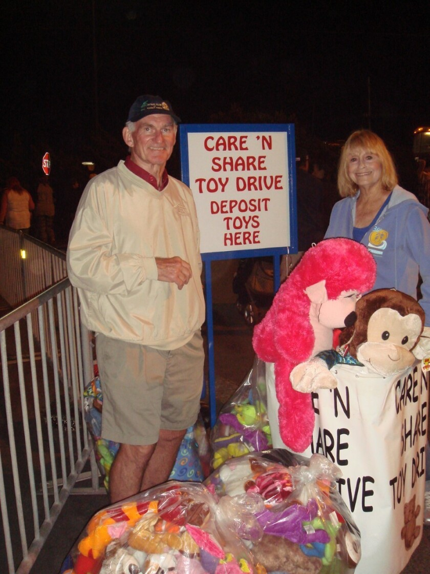 Torrey Pines Rotarians Bill and Carol Irwin collect toys at the Del Mar Fairgrounds.
