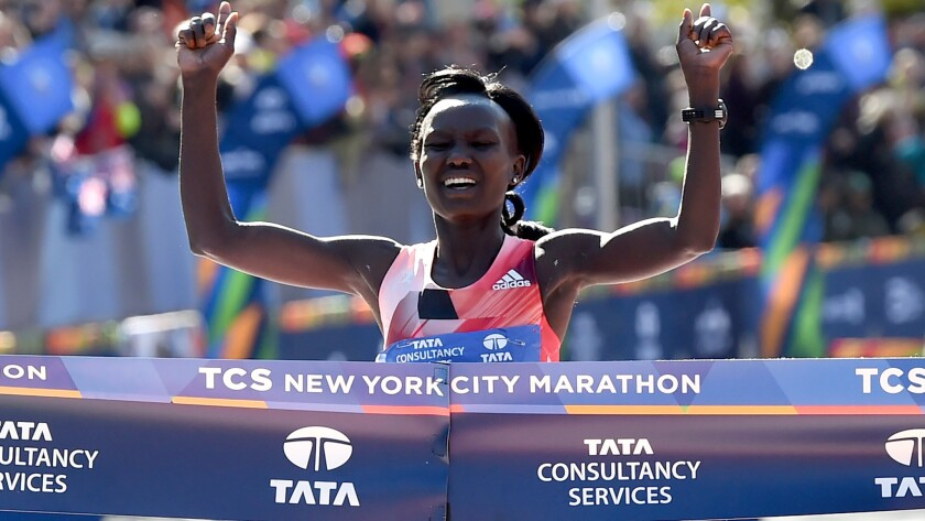 Mary Keitany crosses the finish line Sunday to win her third consecutive New York City Marathon.