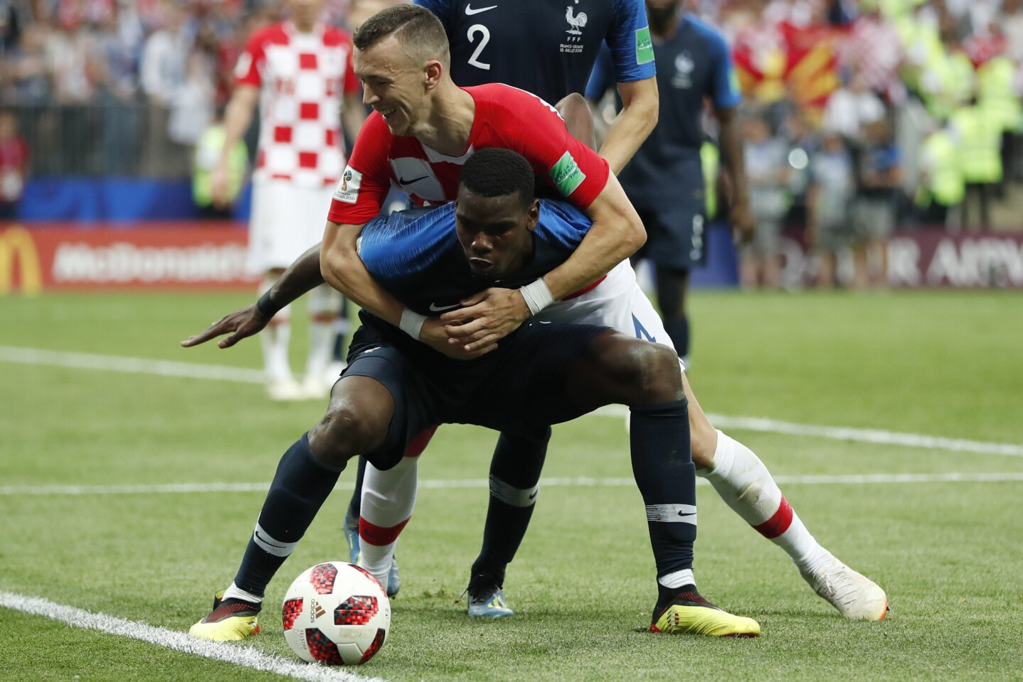 Croatia's Ivan Perisic and France's Paul Pogba battle for the ball during the final match between France and Croatia at the 2018 soccer World Cup in the Luzhniki Stadium in Moscow, Russia, Sunday, July 15, 2018.