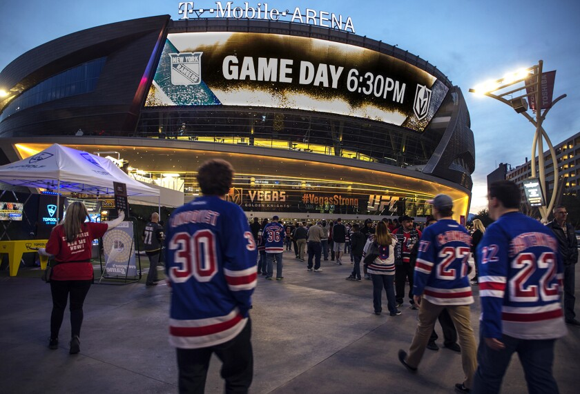 Fans of the New York Rangers walk into T-Mobile Arena in Las Vegas.