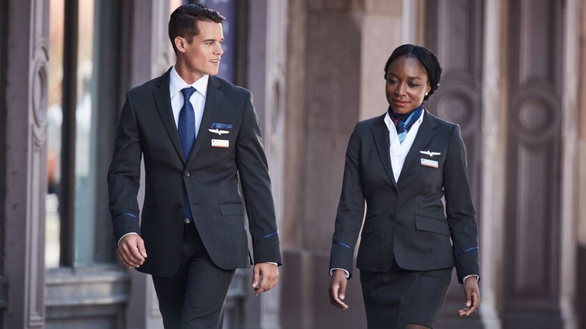 Several American Airlines executives and middle managers are wearing the new uniforms after flight attendants said the clothing causes hives, wheezing, coughing and headaches.