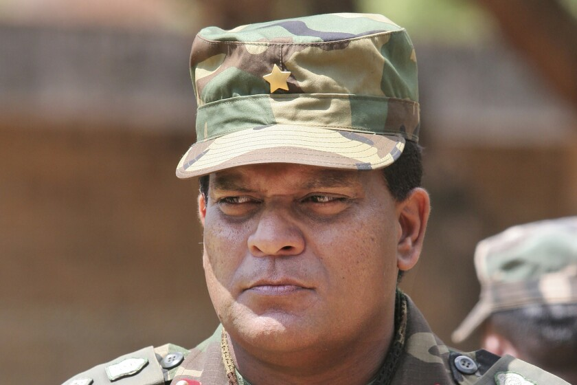 """FILE - This April 24, 2009, file photo shows Sri Lanka's Lt. Gen. Shavendra Silva at a military facility in Kilinochchi, Sri Lanka. The U.S. government on Friday, Feb. 14, 2020, issued a travel ban on Sri Lanka's army chief, saying there is """"credible information of his involvement"""" in human rights violations during the final phase of the island nation's civil war that ended 11 years ago, Secretary of State Michael R. Pompeo said. Silva, and his immediate family members are now prohibited from traveling to the U.S. in a ban that was quickly denounced by Sri Lanka's government, which said """"there were no substantiated or proven allegations of human rights violations"""" committed by Silva.(AP Photo/Chamila Karunarathne, File)"""