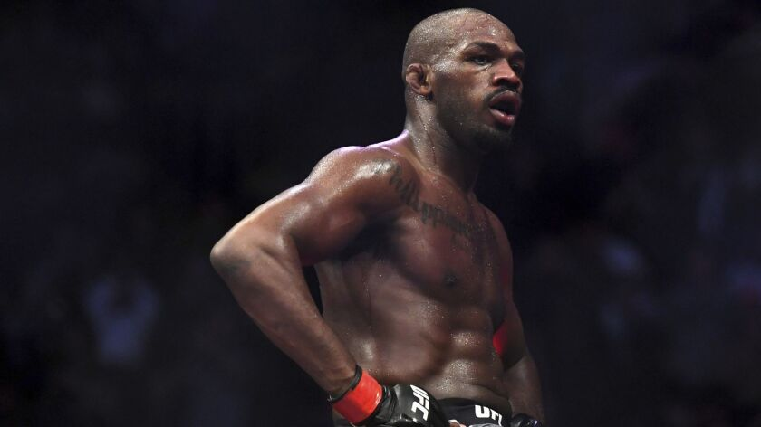Jon Jones goes up on top of the octagon after defeating Alexander Gustafsson in the UFC men's light
