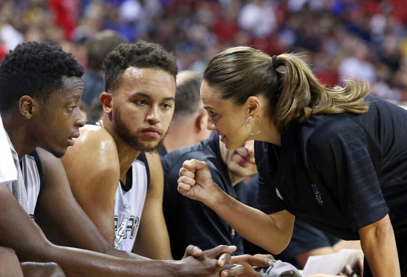 Becky Hammon talks with Cady Lalanne and Kyle Anderson during a summer league game against the New York Knicks on July 11.