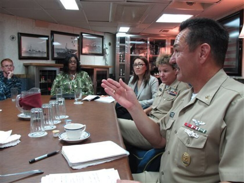 Fleet Master Chief Marco Ramirez of U.S. Pacific Fleet, right, speaks with sailors and victims' advocates about sexual assault aboard the guided missile destroyer USS Paul Hamilton at Pearl Harbor, Hawaii on Thursday, Aug. 8, 2013. Top U.S. Navy commanders in the Asia-Pacific region have formed a task force to discuss sexual assault issues as the branch fights to stem a military-wide problem within its ranks. Leaders in the U.S. Pacific Fleet from all over its wide territory met by teleconferenc