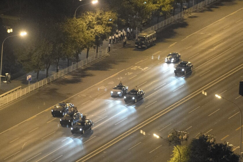 Chinese military vehicles drive on a closed road during a rehearsal for a parade in Beijing marking the 70th anniversary of the end of World War II in Asia.