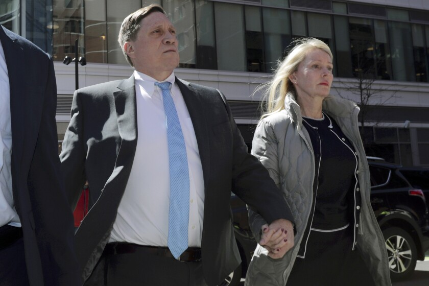 John Wilson arrives at federal court in Boston in April 2019 to face charges in a nationwide college admissions bribery scandal. A federal grand jury in Boston has returned an additional indictment charging Wilson with filing a false tax return.