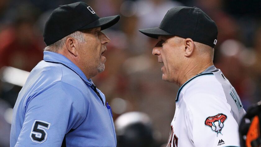 FILE - In this Sept. 10, 2016, file photo, Arizona Diamondbacks' Chip Hale, right, argues with umpir