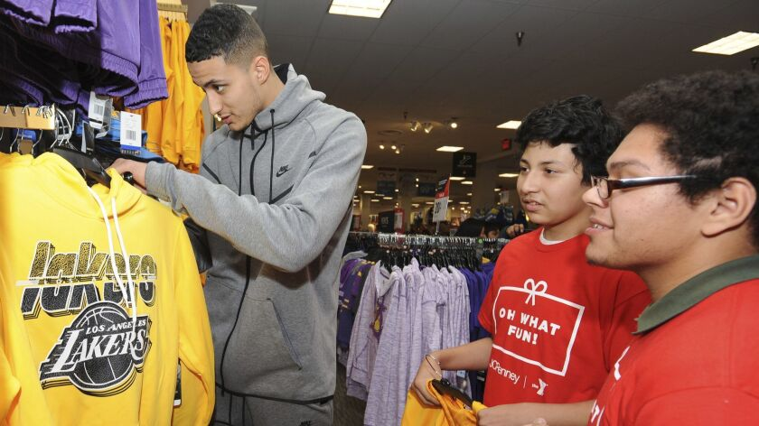 IMAGE DISTRIBUTED FOR JCPENNEY - Los Angeles Lakers Kyle Kuzma helps pick out Lakers apparel for Wei