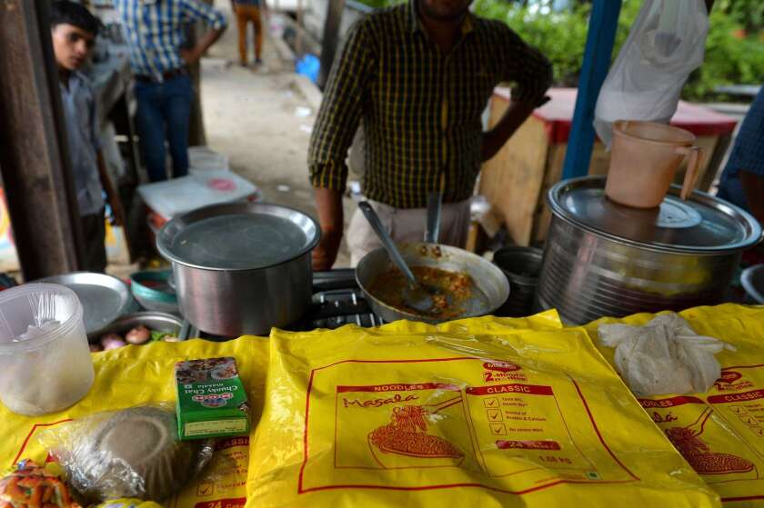 An Indian man prepares Nestle Maggi instant noodles at his roadside food stall on the outskirts of New Delhi.