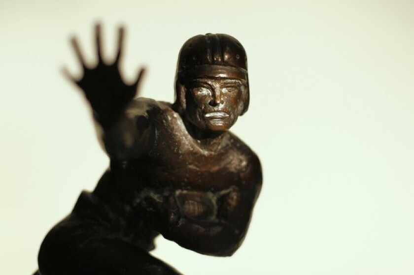 The first 1935 Downtown Athletic Club trophy. Following the death of John Heisman in 1936, the award was renamed the Heisman Memorial Trophy.