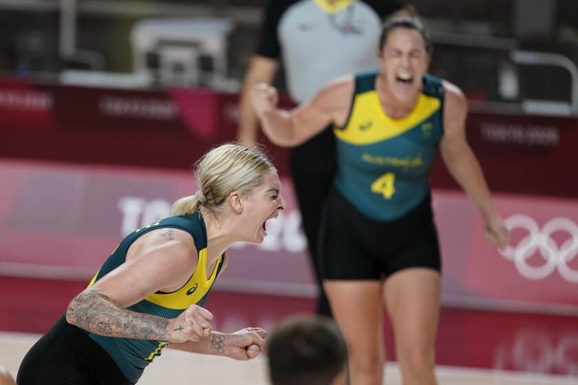 Australia's Cayla George, left, celebrates after making a basket during a women's basketball preliminary round game against Puerto Rico at the 2020 Summer Olympics, Monday, Aug. 2, 2021, in Saitama, Japan. (AP Photo/Charlie Neibergall)
