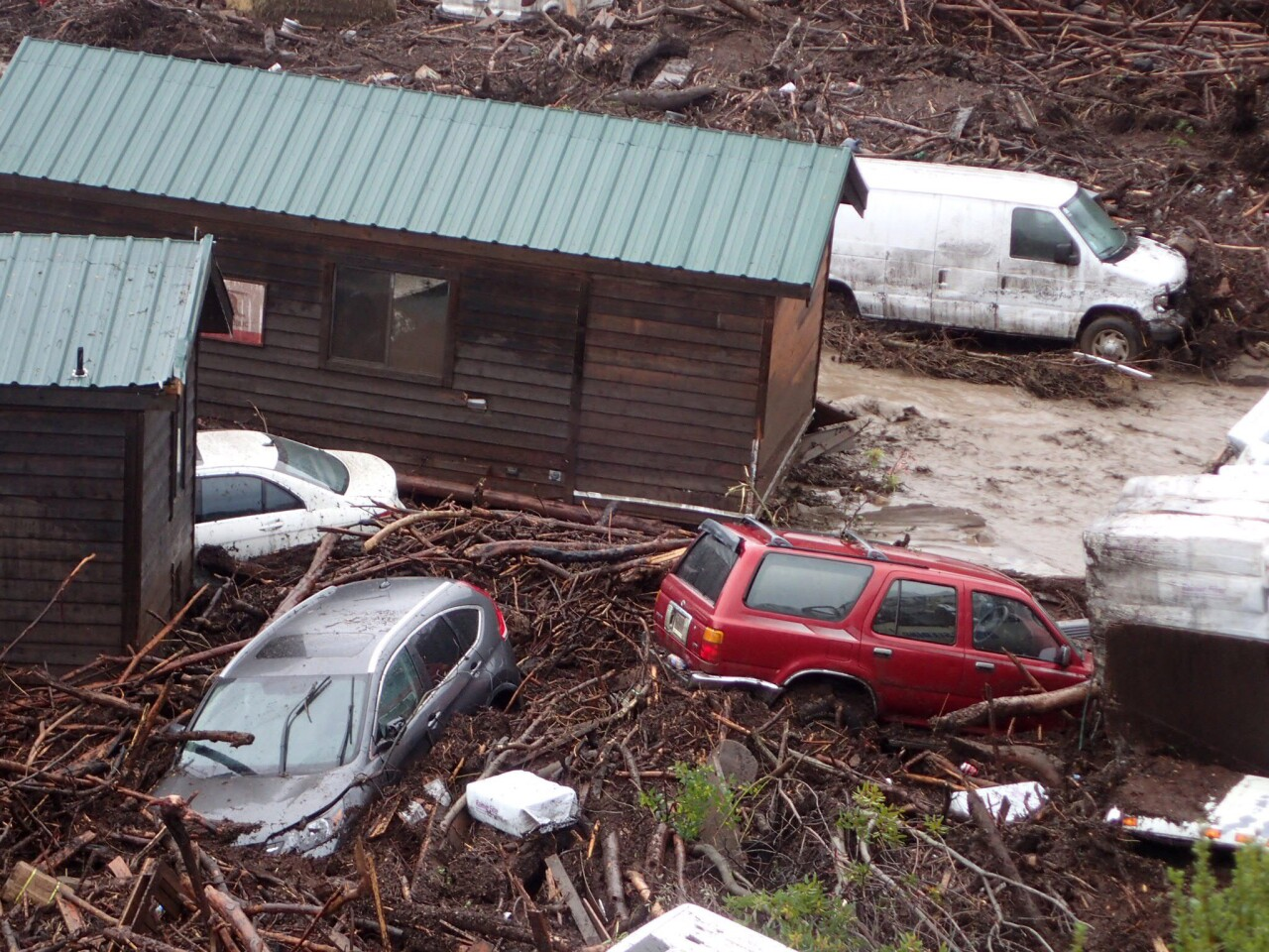 Cabins and vehicles are swept away by storm runoff at El Capitan Canyon Resort & Campground in Gaviota on Friday.