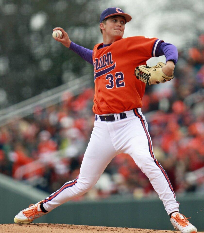 FILE - In this March 2, 2013 filephoto, Clemson's Clate Schmidt throws a pitch against South Carolina during an NCAA college baseball game at Fluor Field in Greenville, S.C. Schmidt threw 77 pitches in a win over Maine on Saturday, Feb. 19, 2016, six months after his cancer went into remission. (Mark Crammer /The Independent-Mail via AP, File) THE GREENVILLE NEWS OUT, SENECA NEWS OUT; MANDATORY CREDIT