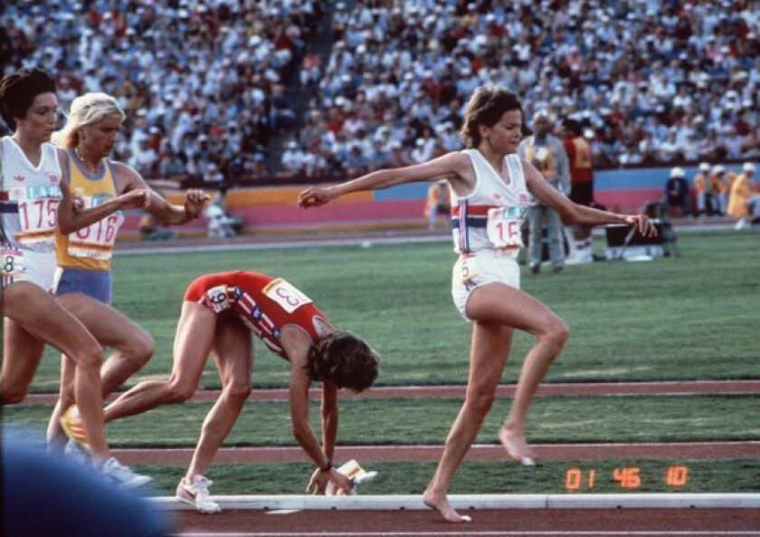 Mary Decker gets tangled up with Zola Budd and falls in the women's 3,000 meters.