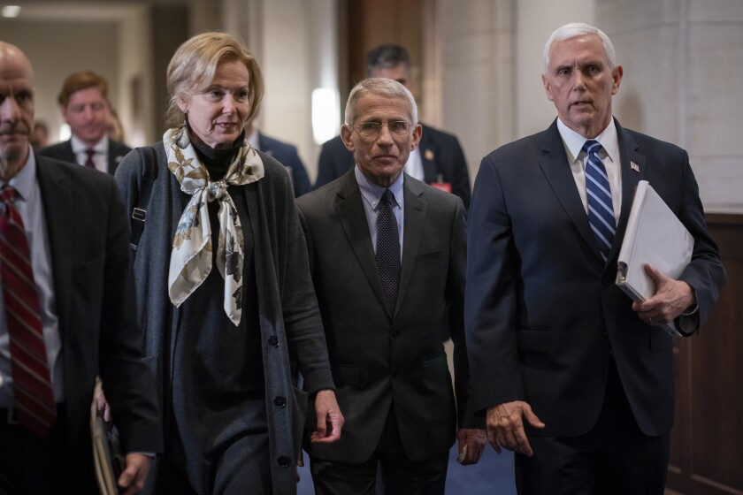 Dr. Deborah Birx, left, the coronavirus response coordinator, and Dr. Anthony Fauci, center, director of the National Institute of Allergy and Infectious Diseases, walk with Vice President Mike Pence, right, as they walk on Capitol Hill in Washington, Wednesday, March 4, 2020. Congressional negotiators have reached agreement on an $8.3 billion bill to fund the government's response to the public health emergency. (AP Photo/J. Scott Applewhite)