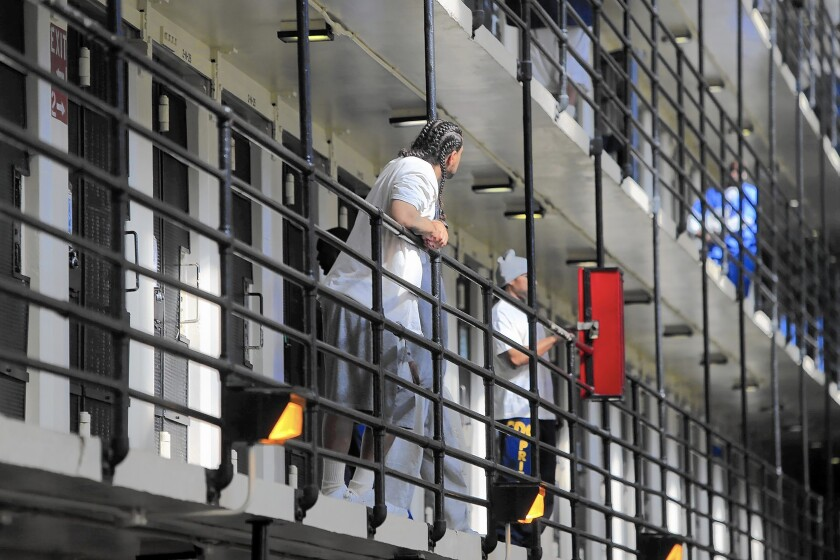 Officials earlier estimated $400 million in unemployment benefits had been paid on fraudulent claims in inmates' names.
