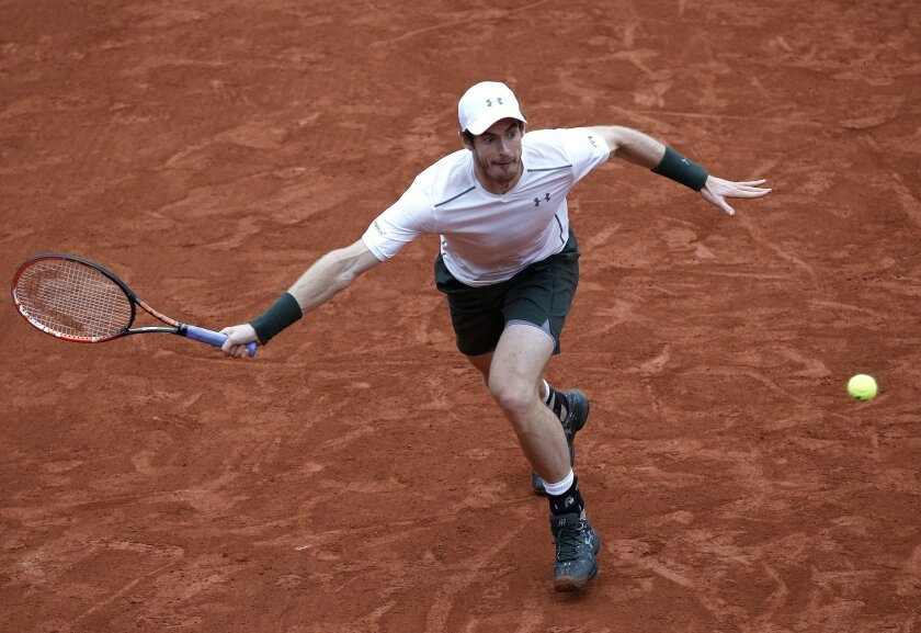 Britain's Andy Murray returns the ball to Switzerland's Stan Wawrinka during their semifinal match of the French Open tennis tournament at the Roland Garros stadium, Friday, June 3, 2016 in Paris. (AP Photo/Christophe Ena)