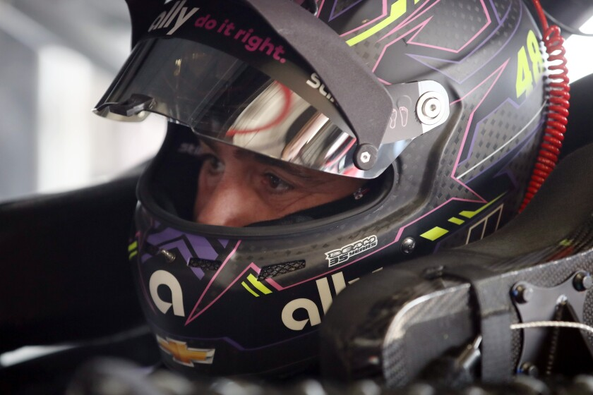 Jimmie Johnson waits in his car during a practice session at Auto Club Speedway on Friday.
