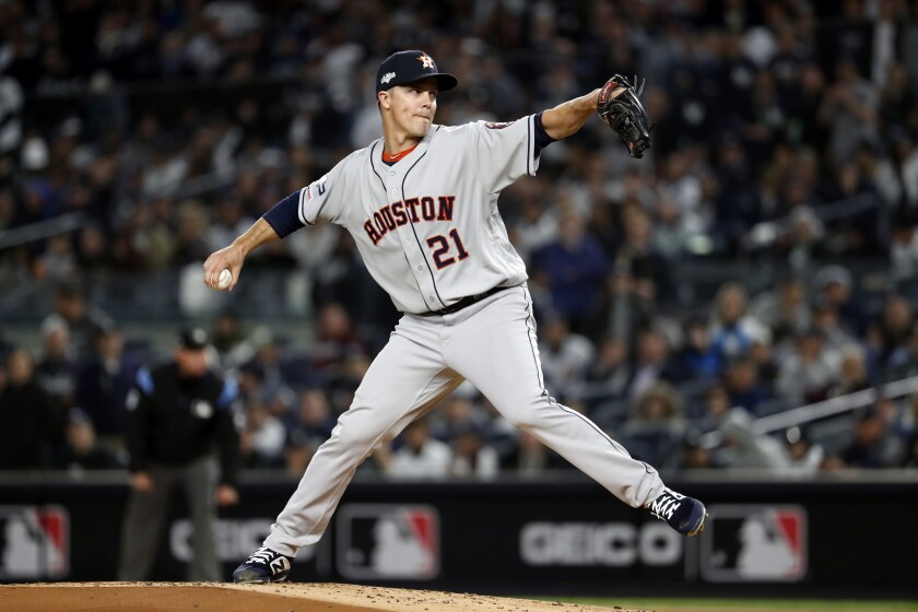 Houston Astros starting pitcher Zack Greinke delivers against the New York Yankees.