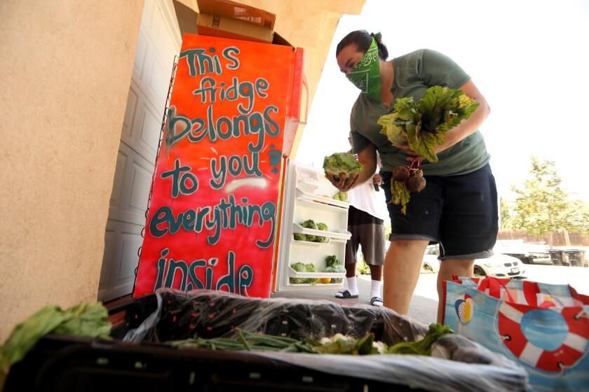 Paloma Vergara loads up a community refrigerator.