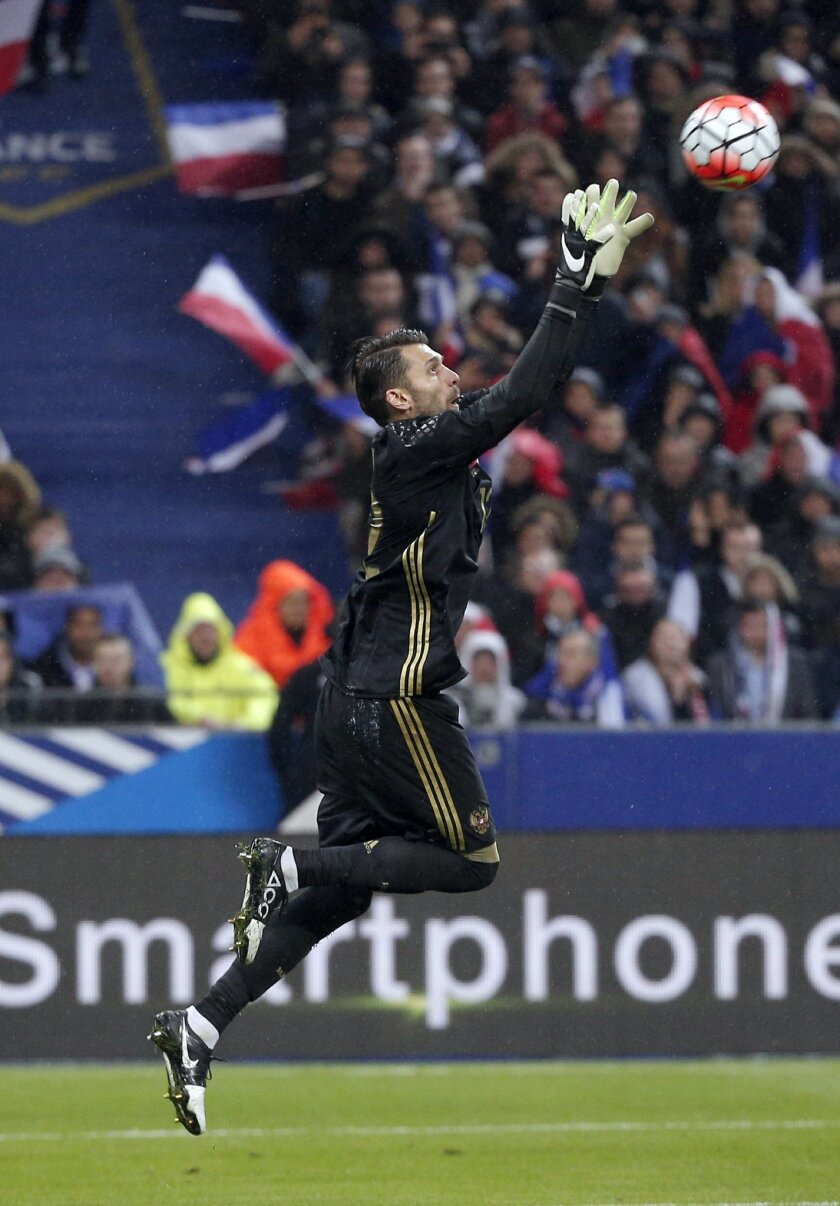 FILE - In this Tuesday, March 29, 2016 file photo, Russia goalkeeper Igor Akinfeev reaches for the ball during the international friendly soccer match between France and Russia in Saint Denis, north of Paris, France. (AP Photo/Thibault Camus, File)