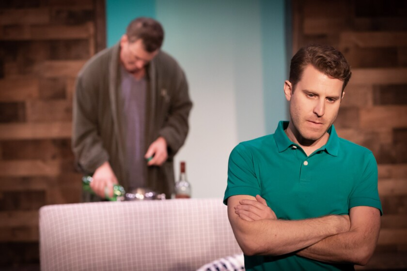 """Andrew Carter (with Josh Randall in the background) plays the protagonist of Rider Strong's new play """"Never Ever Land,""""  a Theatre Unleashed production in L.A.'s Koreatown."""