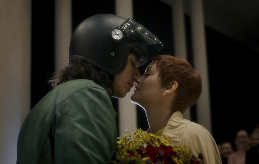 """This image released by Amazon Studios shows Adam Driver, left, and Marion Cotillard in a scene from """"Annette."""" (Amazon via AP)"""