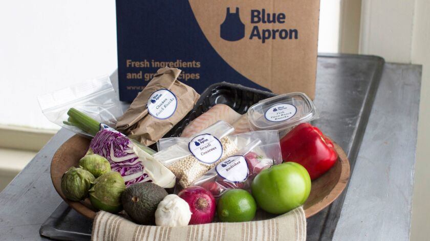 This Oct. 6, 2014, photo shows an example of a home delivered meal from Blue Apron, in Concord, N.H.